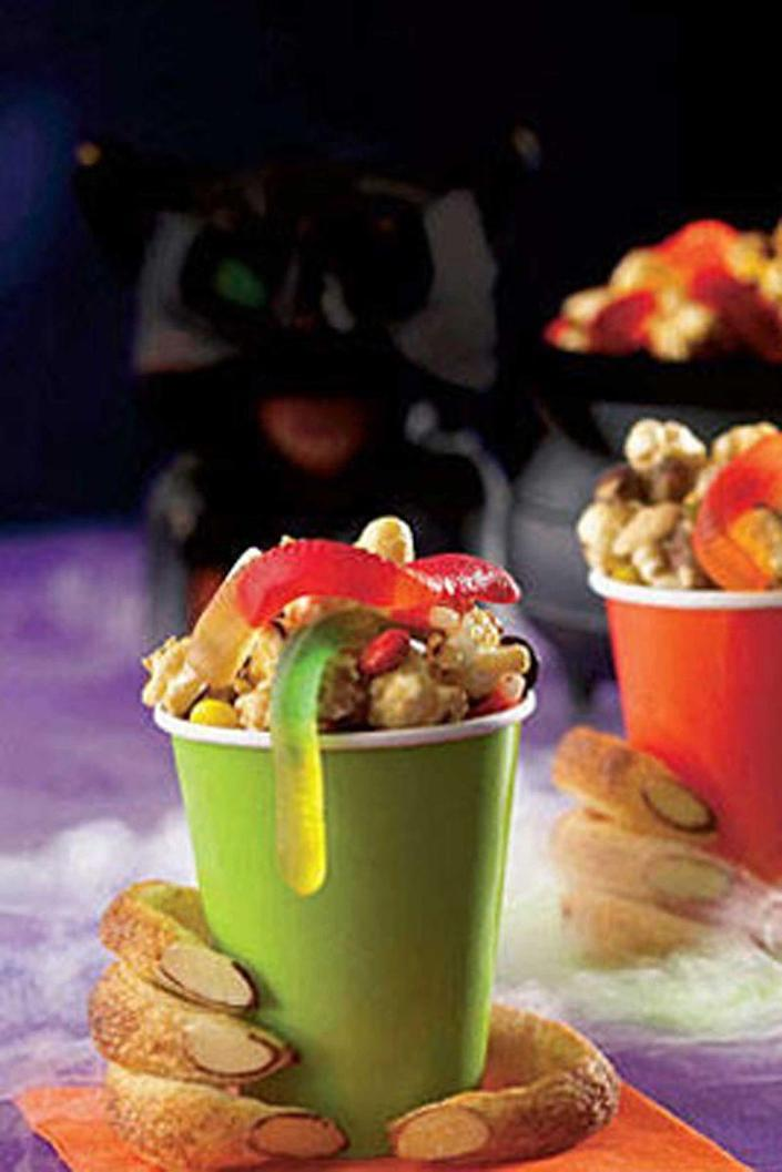 """<p>Gummy worms add the perfect touch to this crowd-pleasing party mix. It's a perfect combo of salty and sweet that can be ready in 10 minutes flat.</p><p><em><strong><a href=""""https://www.womansday.com/food-recipes/food-drinks/recipes/a10555/monster-munch-121659/"""" rel=""""nofollow noopener"""" target=""""_blank"""" data-ylk=""""slk:Get the Monster Munch recipe."""" class=""""link rapid-noclick-resp"""">Get the Monster Munch recipe.</a></strong></em></p>"""