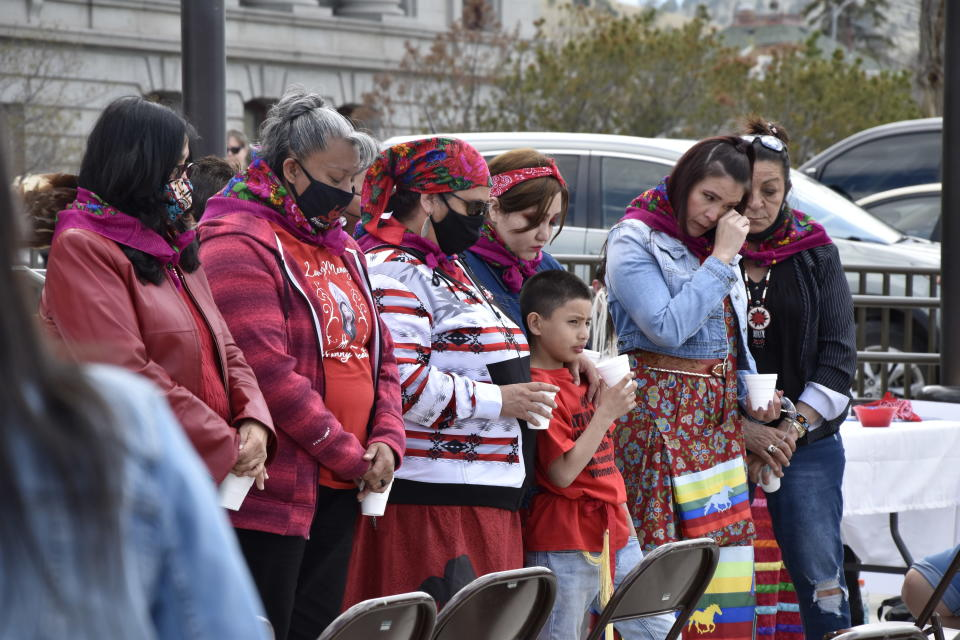 "Family members of missing and murdered indigenous women in Montana gather in front of the state Capitol in Helena, Mont., Wednesday, May 5, 2021. They received colorful shawls in a traditional Native American ceremony called ""wiping away of tears."" From Washington to Indigenous communities across the American Southwest, top government officials, family members and advocates gathered Wednesday as part of a call to action to address the ongoing problem of violence against Indigenous women and children. (AP Photo/Iris Samuels)"