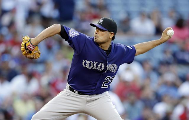 Colorado Rockies starting pitcher Jorge De La Rosa (29) works in the first inning of a baseball game against the Atlanta Braves in Atlanta, Monday, July 29, 2013. (AP Photo/John Bazemore)