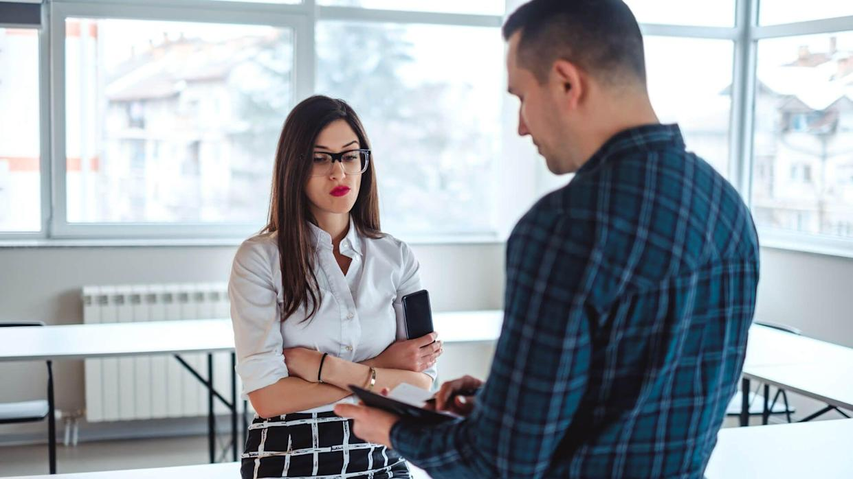 female colleague annoyed upset by male boss