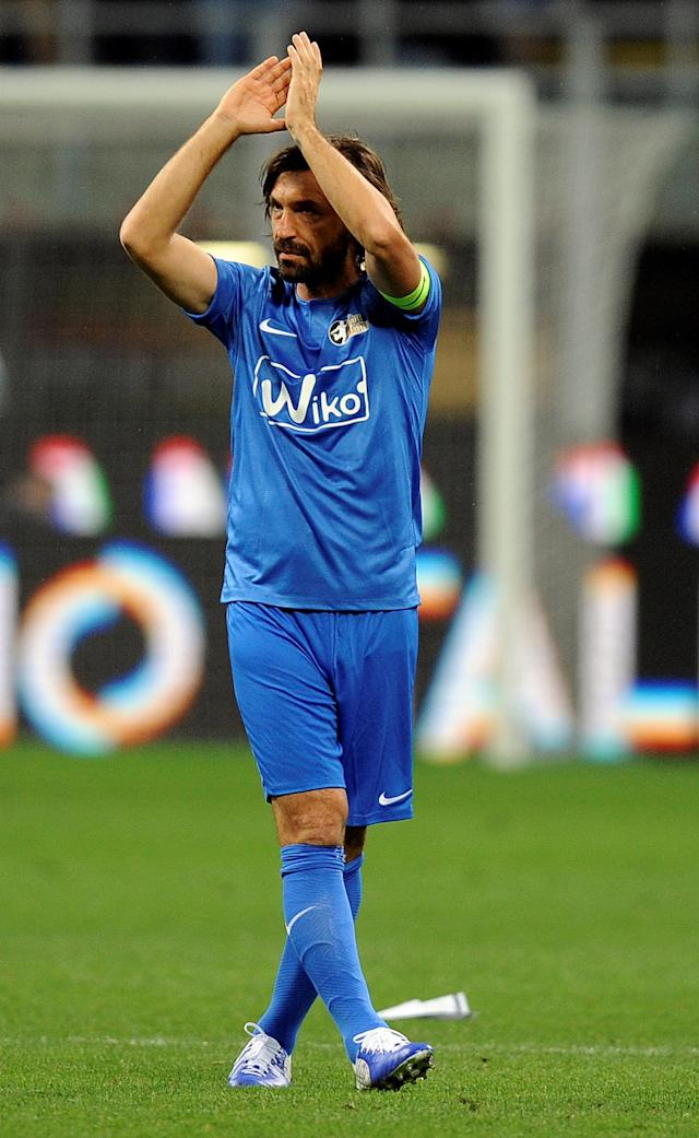 Former Italian soccer player Andrea Pirlo waves during his farewell soccer match at the San Siro stadium in Milan, Italy, May 21, 2018. REUTERS/Daniele Mascolo
