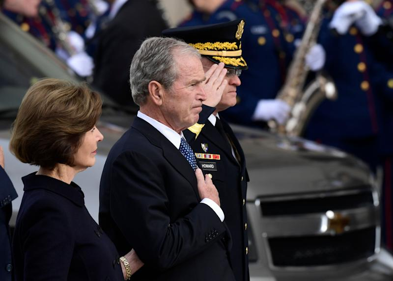 George W. Bush is seen beside his wife, Laura Bush, as the casket of his late father arrives at the National Cathedral. (Photo: ASSOCIATED PRESS)