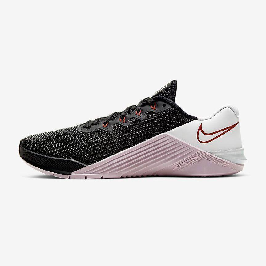 """<p><strong>Nike</strong></p><p>nike.com</p><p><strong>$130.00</strong></p><p><a href=""""https://go.redirectingat.com?id=74968X1596630&url=https%3A%2F%2Fwww.nike.com%2Ft%2Fmetcon-5-womens-training-shoe-2xvQ6H&sref=https%3A%2F%2Fwww.goodhousekeeping.com%2Fhealth-products%2Fg32379201%2Fbest-workout-shoes-for-women%2F"""" rel=""""nofollow noopener"""" target=""""_blank"""" data-ylk=""""slk:Shop Now"""" class=""""link rapid-noclick-resp"""">Shop Now</a></p><p>For safety and support, weight lifters should opt for workout shoes with a flat, stable bottom that'll keep them level when handling heavy weights. Also great for HIIT or CrossFit, the outsole is designed for strong grip, extending on the sides of the sneaker for support when rope climbing. The <strong>f</strong><strong>oam is firmer at the heel and softer in the forefoot to cushion high impact activities.</strong> Plus, you can customize these workout shoes to be your favorite colors!</p>"""