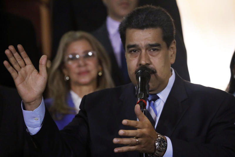 """FILE - In this Friday, June 21, 2019, file photo, Venezuela's President Nicolas Maduro speaks at a news conference in Caracas, Venezuela. When much of Venezuela was plunged into darkness after a massive blackout in July 2019, Maduro blamed the power outage on an """"electromagnetic attack"""" carried out by the United States. (AP Photo/Ariana Cubillos, File)"""