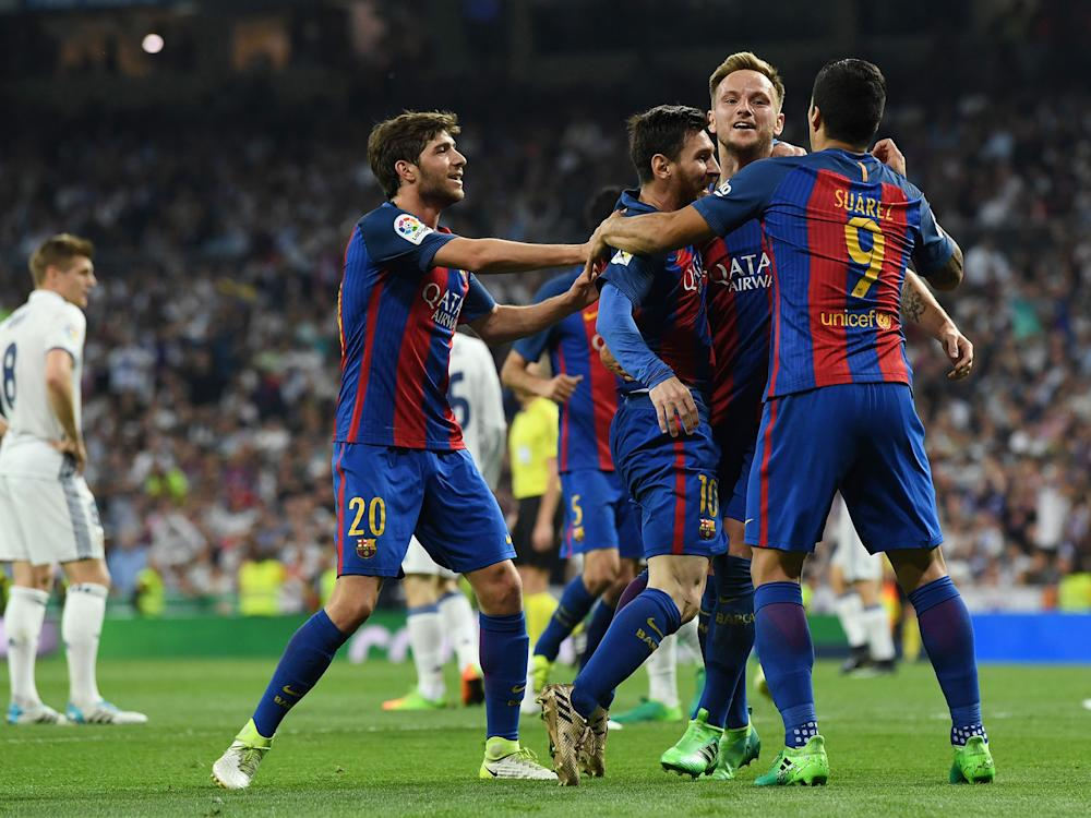 Barcelona celebrate as Lionel Messi inspired the 3-2 victory over Real Madrid: Getty