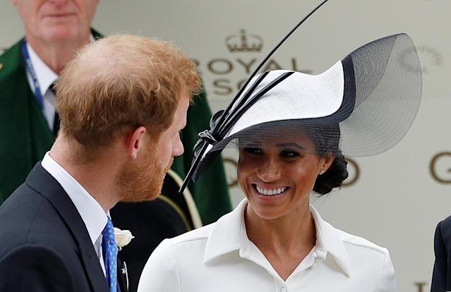 Horse Racing - Royal Ascot - Ascot Racecourse, Ascot, Britain - June 19, 2018 Britain's Prince Harry and Meghan, the Duchess of Sussex look on during a trophy presentation REUTERS/Peter Nicholls
