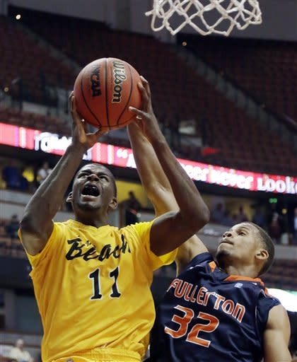 Long Beach State's James Ennis (11) shoots against Cal State Fullerton guard Chris Collins in the second half of an NCAA college basketball game in the Big West Conference men's tournament Thursday, March 14, 2013, in Anaheim, Calif. Long Beach State won 75-66. (AP Photo/Reed Saxon)