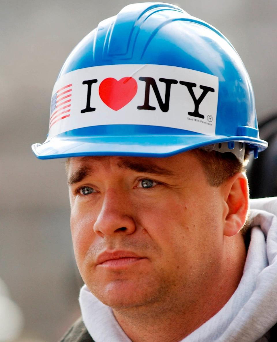 New York City firefighter Kevin Bohan at a memorial service near ground zero in New York - Stan Honda/AP Photo