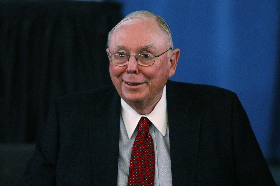 Berkshire Hathaway Vice Chairman Charlie Munger arrives to begin the company's annual meeting in Omaha May 4, 2013. Warren Buffett and the board of his conglomerate Berkshire Hathaway Inc are