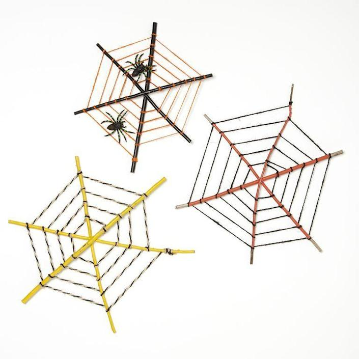 """<p>These colorful DIY webs can easily be hung from a window, porch eave, or the branches of a tree.</p><p><strong><em><a href=""""https://www.womansday.com/home/crafts-projects/a28713677/painted-web/"""" rel=""""nofollow noopener"""" target=""""_blank"""" data-ylk=""""slk:Get the Painted Web tutorial"""" class=""""link rapid-noclick-resp"""">Get the Painted Web tutorial</a>. </em></strong></p><p><a class=""""link rapid-noclick-resp"""" href=""""https://www.amazon.com/String-Cotton-Bakers-Christmas-Holiday/dp/B07KFFJLDC?tag=syn-yahoo-20&ascsubtag=%5Bartid%7C10070.g.2488%5Bsrc%7Cyahoo-us"""" rel=""""nofollow noopener"""" target=""""_blank"""" data-ylk=""""slk:SHOP TWINE"""">SHOP TWINE</a></p>"""