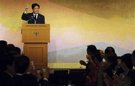 Abe raises the glass for the toast with ASEAN countries' leaders during a gala dinner in Tokyo