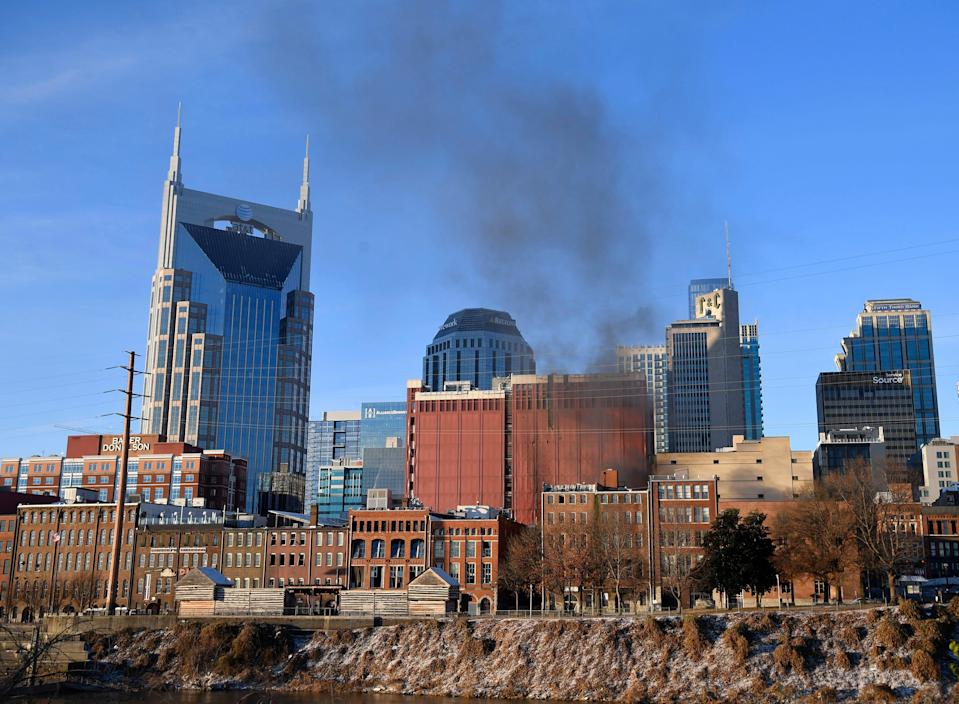 Smoke rises from downtown after an explosion in the area of Second and Commerce Friday, Dec. 25, 2020 in Nashville, Tenn.