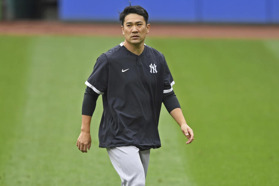 FILE - New York Yankees starting pitcher Masahiro Tanaka walks on the field before Game 1 of an American League wild-card baseball series against the Cleveland Indians in Cleveland, in this Tuesday, Sept. 29, 2020, file photo. Former New York Yankees pitcher Masahiro Tanaka has signed a two-year contract with the Rakuten Eagles in Japanese baseball, the club said Thursday, Jan. 28, 2021. (AP Photo/David Dermer, File)