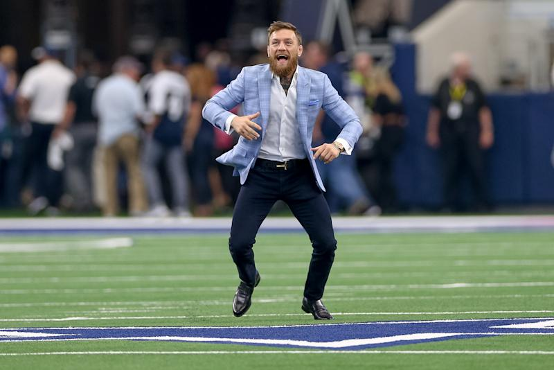 ARLINGTON, TX - OCTOBER 14: Former UFC Champion Conor McGregor plays catch on the field prior to the game between the Jacksonville Jaguars and Dallas Cowboys on October 14, 2018 at AT&T Stadium in Arlington, TX. (Photo by Andrew Dieb/Icon Sportswire via Getty Images)