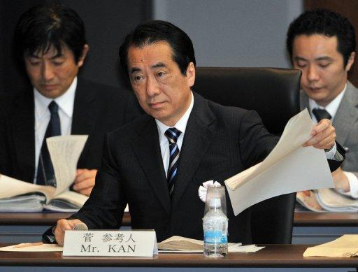 Former Japanese prime minister Naoto Kan (C) speaks at a parliamentary commission in Tokyo in May 2012