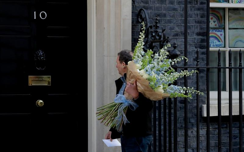Flowers are delivered to 10 Downing Street after Boris Johnson's partner Carrie Symonds gave birth to baby Wilfred - AP