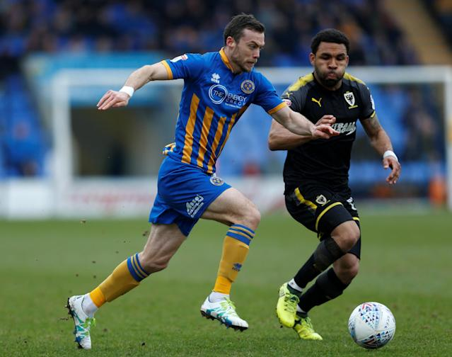 "Soccer Football - League One - Shrewsbury Town vs AFC Wimbledon - Montgomery Waters Meadow, Shrewsbury, Britain - March 24, 2018 Shaun Whalley of Shrewsbury Town and Andy Barcham of AFC Wimbledon in action Action Images/Ed Sykes EDITORIAL USE ONLY. No use with unauthorized audio, video, data, fixture lists, club/league logos or ""live"" services. Online in-match use limited to 75 images, no video emulation. No use in betting, games or single club/league/player publications. Please contact your account representative for further details."