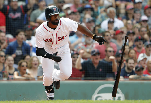 Boston Red Sox's Jackie Bradley Jr. watches his double against the Toronto Blue Jays during the ninth inning of a baseball game Saturday, July 14, 2018, in Boston. (AP Photo/Winslow Townson)