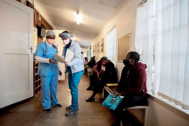 PHOTO: Doctors look at a files at the Respiratory & Meningeal Pathogens Research Unit at the Chris Hani Baragwanath Hospital in Soweto, South Africa, on July 14, 2020. (Luca Sola/AFP via Getty Images)