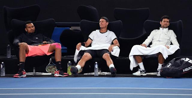 "Nick Kyrgios, (L) Lleyton Hewitt (C) and Novak Djokovic watch the action during the ""Tie Break Tens"" tennis tournament in Melbourne (AFP Photo/WILLIAM WEST)"