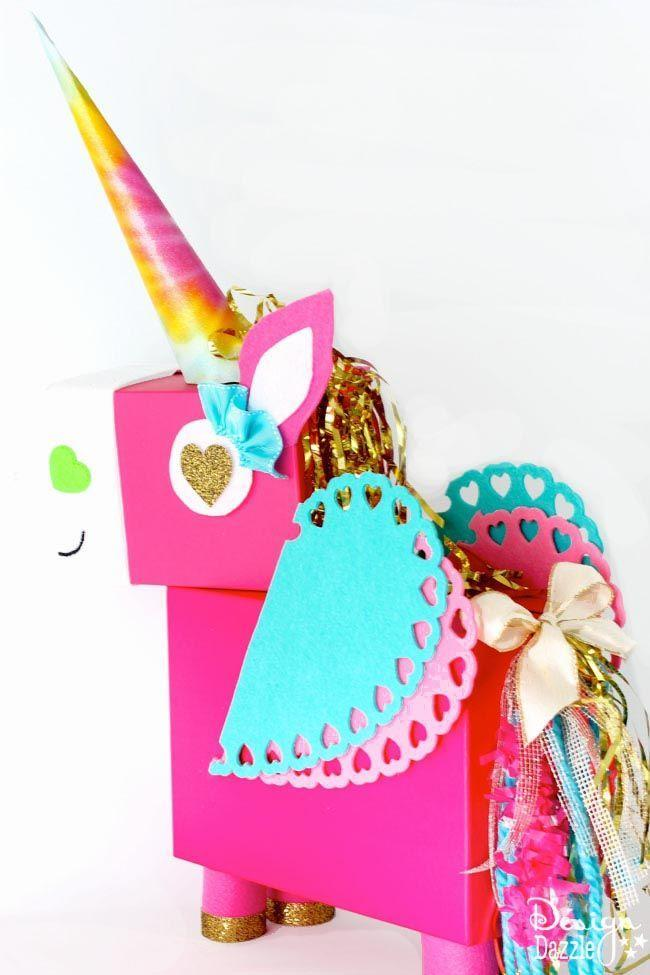 "<p>Take on the unicorn trend with this elaborate interpretation of the otherworldly animals.</p><p><strong>Get the tutorial at <a href=""https://www.designdazzle.com/unicorn-valentines-day-card-box/"" rel=""nofollow noopener"" target=""_blank"" data-ylk=""slk:Design Dazzle"" class=""link rapid-noclick-resp"">Design Dazzle</a>.</strong></p><p><strong><a class=""link rapid-noclick-resp"" href=""https://www.amazon.com/s/ref=nb_sb_noss?url=search-alias%3Daps&field-keywords=gold+fringe&tag=syn-yahoo-20&ascsubtag=%5Bartid%7C10050.g.25844424%5Bsrc%7Cyahoo-us"" rel=""nofollow noopener"" target=""_blank"" data-ylk=""slk:SHOP GOLD FRINGE"">SHOP GOLD FRINGE</a><br></strong></p>"
