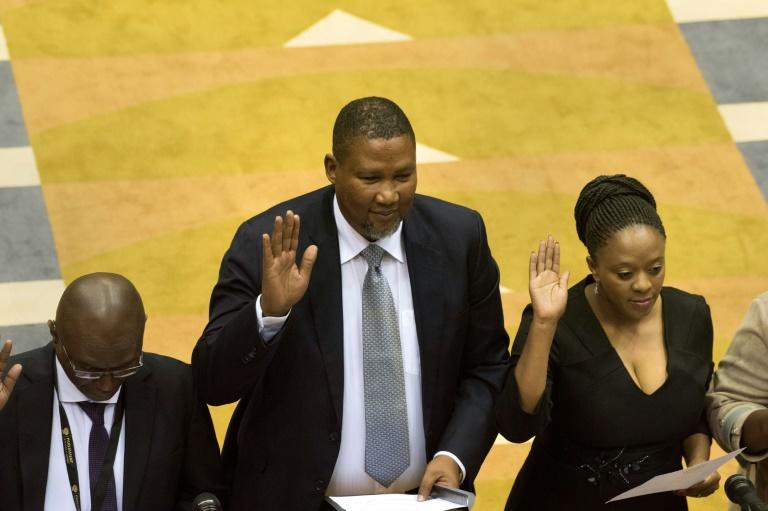 Oath of office: Mandla Mandela, centre, the grandson of Nelson Mandela, was sworn in alongside other newly-elected MPs