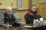 Alaska Gov. Mike Dunleavy, right, and state Sen. Bert Stedman are shown during a meeting with area leaders in Ketchikan, Alaska, on Thursday, April 22, 2021. Dunleavy visited Ketchikan as part of a one-day trip in southeast Alaska that included travel by small float plane to the communities of Hyder and Metlakatla. (AP Photo/Becky Bohrer)
