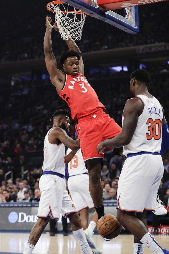 Toronto Raptors' OG Anunoby (3) dunks in front of New York Knicks' Julius Randle (30) during the first half of an NBA basketball game Friday, Jan. 24, 2020, in New York. (AP Photo/Frank Franklin II)