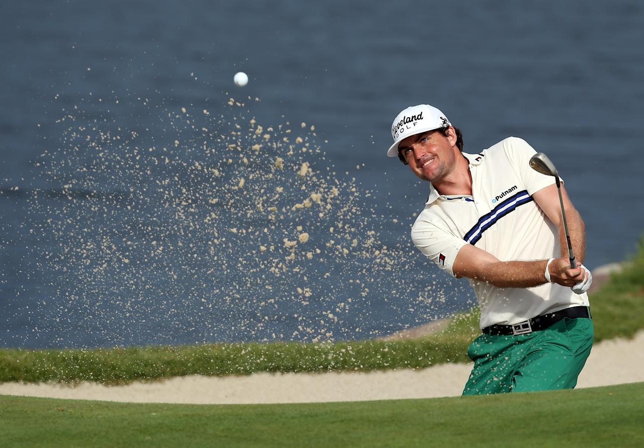 JERSEY CITY, NJ - AUGUST 23: Keegan Bradley of the United States hits out of a bunker on the 13th hole during a continuation of the first round on the second day of The Barclays at Liberty National Golf Club on August 23, 2013 in Jersey City, New Jersey. (Photo by Jeff Gross/Getty Images)