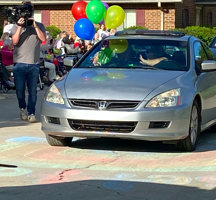 The parade was in full swing as residents waved and cheered to passing cars. (Photo: Jenny Brinkle)