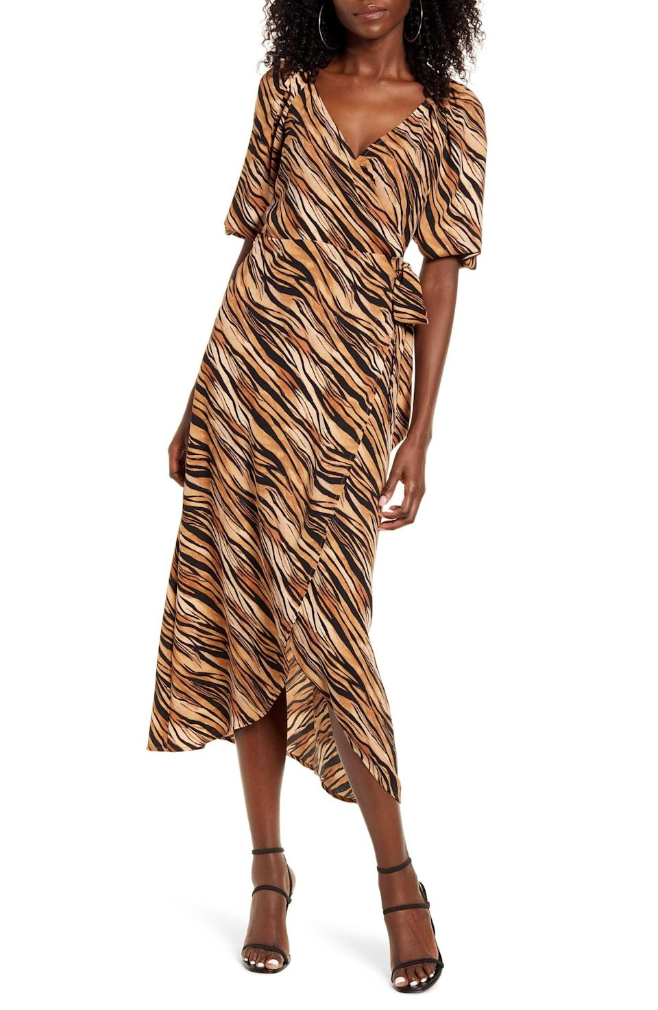 "<p>If you love animal print, then no doubt the <a href=""https://www.popsugar.com/buy/Leith-Print-Midi-Wrap-Dress-586432?p_name=Leith%20Print%20Midi%20Wrap%20Dress&retailer=shop.nordstrom.com&pid=586432&price=32&evar1=fab%3Aus&evar9=47589535&evar98=https%3A%2F%2Fwww.popsugar.com%2Ffashion%2Fphoto-gallery%2F47589535%2Fimage%2F47590109%2FLeith-Print-Midi-Wrap-Dress&list1=shopping%2Cdresses%2Csummer%2Csummer%20fashion%2Cfashion%20shopping&prop13=mobile&pdata=1"" class=""link rapid-noclick-resp"" rel=""nofollow noopener"" target=""_blank"" data-ylk=""slk:Leith Print Midi Wrap Dress"">Leith Print Midi Wrap Dress</a> ($32, originally $79) is for you.</p>"