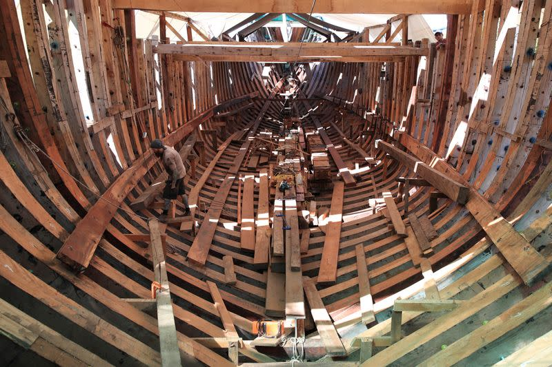A man works in the construction of Ceiba, an ecological sailboat that will work with solar panels, electric and hydraulic energy to reduce to almost zero its carbon footprint, at a shipyard in Punta Morales