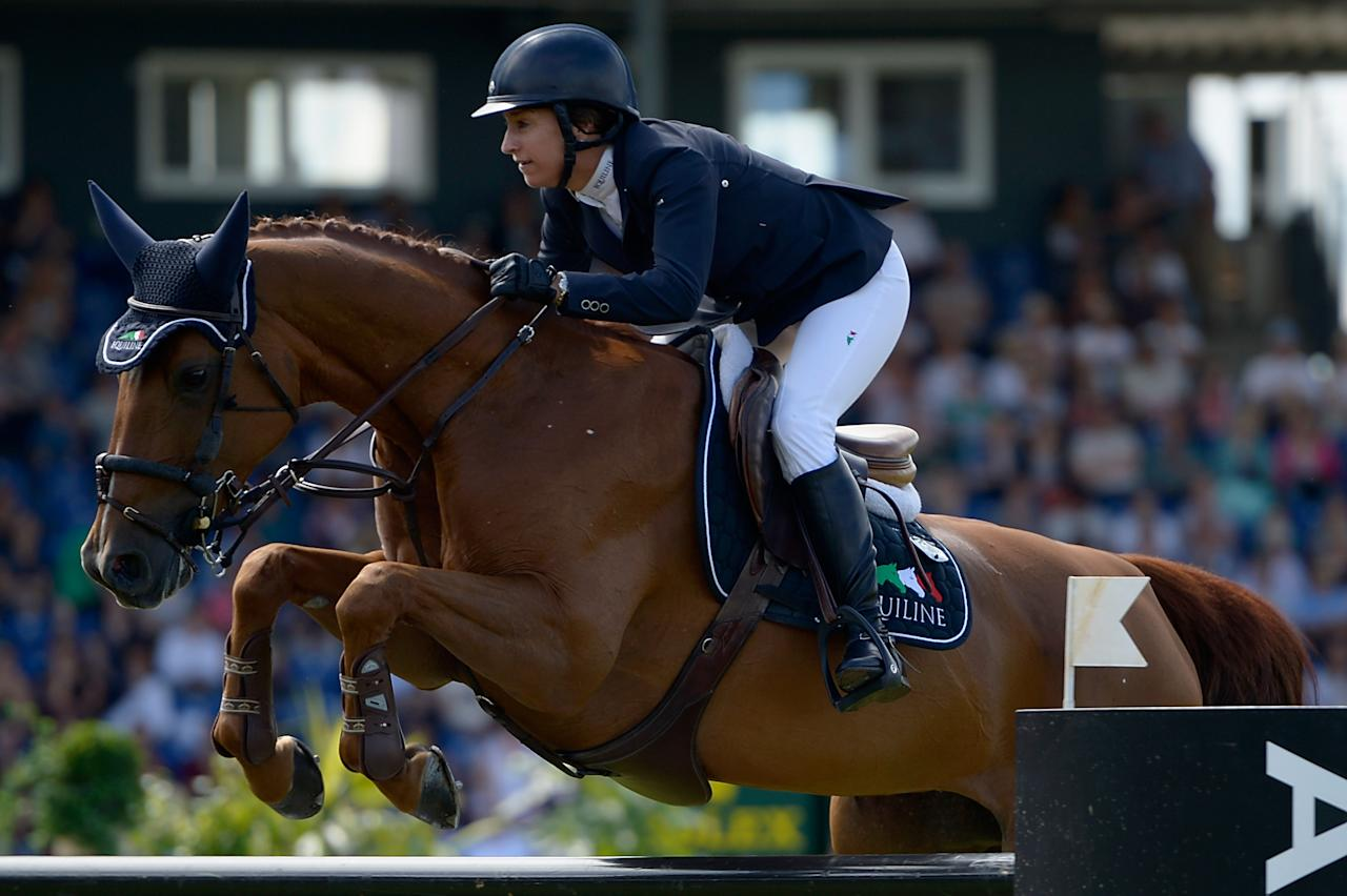 AACHEN, GERMANY - JULY 07:  Laura Kraut of USA and her horse Teirra compete in the Prize of AachenMuenchener jumping competition during day five of the 2012 CHIO Aachen tournament on July 7, 2012 in Aachen, Germany.  (Photo by Dennis Grombkowski/Bongarts/Getty Images)