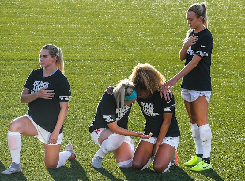HERRIMAN, UT - JUNE 27: Julie Ertz #8 and Rachel Hill #5 hold Casey Short #6 of the Chicago Red Stars kneel during the playing of the national anthem prior to a game against the Washington Spirit in the first round of the NWSL Challenge Cup at Zions Bank Stadium on June 27, 2020 in Herriman, Utah. (Photo by Alex Goodlett/Getty Images)