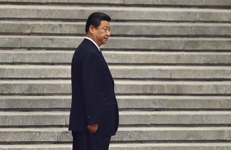 File photo of China's President Xi Jinping waiting before a welcoming ceremony outside the Great Hall of the People in Beijing