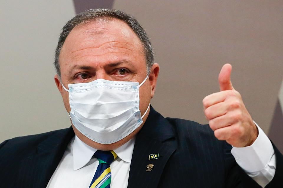 Brazilian former Minister of Health and general of the Brazilian Army, Eduardo Pazuello, gives the thumb up as he declares at a session of the Parliamentary Committee of Inquiry that will investigate the government's handling of the coronavirus pandemic in Brasilia on May 19, 2021. (Photo by Sergio Lima / AFP) (Photo by SERGIO LIMA/AFP via Getty Images)