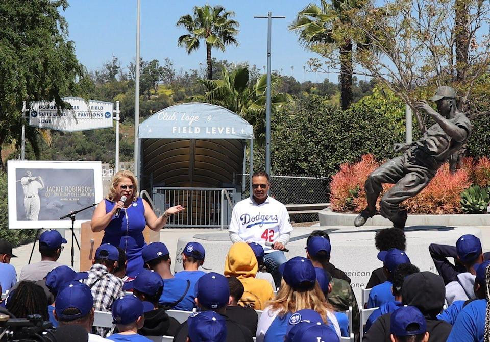 Dave Roberts speaks to students of the BOSS program outside of Jackie Robinson's statue at Dodger Stadium. (Photo courtesy BOSS Program/Victor Roman)
