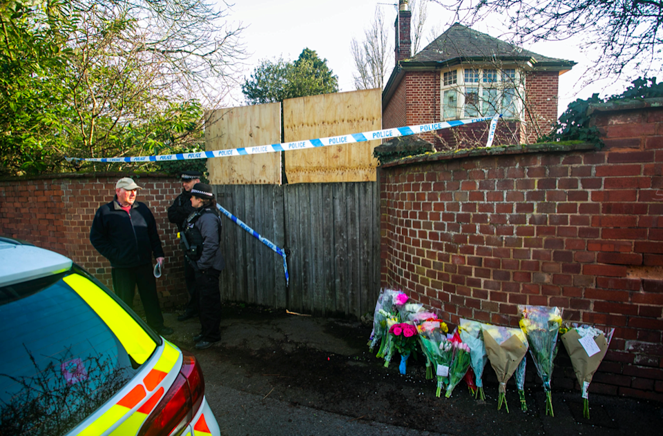 Flowers were left in tribute at the scene of one of the killings (Picture: SWNS)