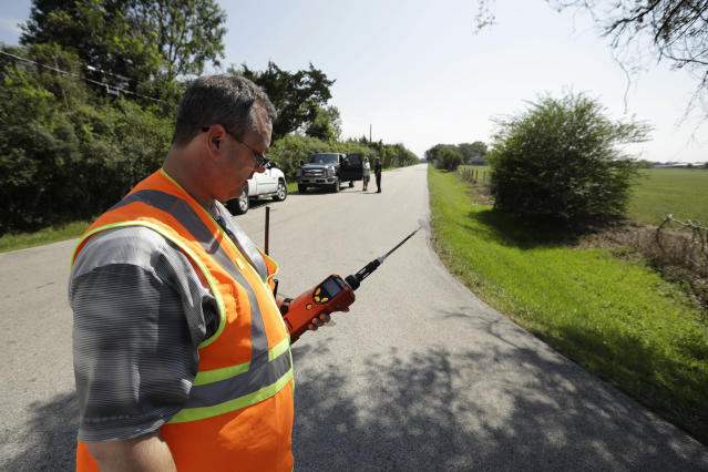 <p>Mike Cossey, of Bureau Veritas, uses an air monitor to check the quality of air at a police roadblock marking the 1.5-mile perimeter of the evacuation area around the Arkema Inc. chemical plant Thursday, Aug. 31, 2017, in Crosby, Texas. (Photo: Gregory Bull/AP) </p>