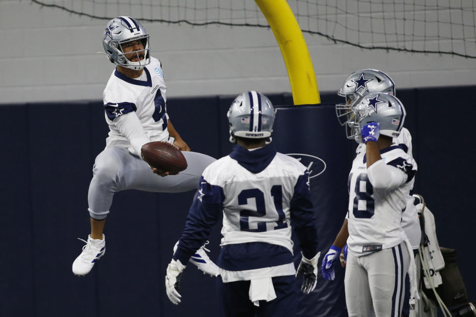 Jun 11, 2019; Frisco, TX, USA; Dallas Cowboys quarterback Dak Prescott (4) jumps to catch a ball during practice at the Ford Center at the Star in Frisco. Mandatory Credit: Tim Heitman-USA TODAY Sports