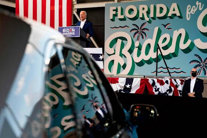 "Democratic Presidential Candidate Joe Biden speaks during a drive in rally in Miramar, Florida on October 13, 2020. - Joe Biden headed for Florida to court elderly Americans who helped elect Donald Trump four years ago but appear to be swinging to the Democratic candidate for the White House this time around amid the coronavirus pandemic. Biden, at 77 the oldest Democratic nominee ever, is to ""deliver his vision for older Americans"" at an event in the city of Pembroke Pines, north of Miami, his campaign said. (Photo by JIM WATSON / AFP) (Photo by JIM WATSON/AFP via Getty Images)"