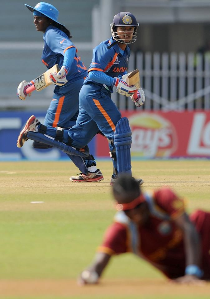 Indian cricketers Thirush Kamini (L) and  Punam Raut (R) take a run during the inaugural match of the ICC Women's World Cup 2013 between India and West Indies at the Cricket Club of India's Brabourne stadium in Mumbai on January 31, 2013. Teams from Australia, England, New Zealand, Pakistan, South Africa, Sri Lanka, West Indies join hosts India for the global event which is being played from 31 January to 17 February.  The women's World Cup opened in Mumbai with the cricketers hoping to put aside memories of the unsavoury build-up and gain their due recognition in a country where the men's game reigns supreme. AFP PHOTO/ Indranil MUKHERJEE        (Photo credit should read INDRANIL MUKHERJEE/AFP/Getty Images)