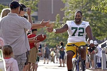 Bike ride to and from training-camp practices is one of the many things that uniquely connects Packers players to their fans