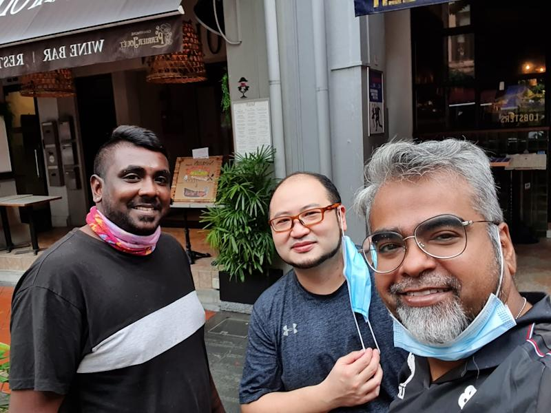 Victor Shaqur, 48, who started a food delivery service called Dropoff, with some of his riders. (PHOTO: Victor Shaqur)