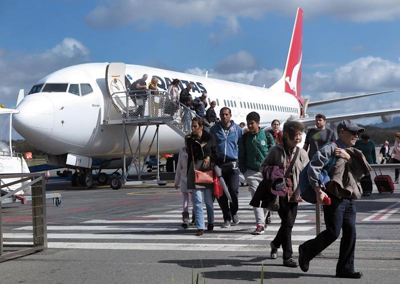 File photo shows passengers disembarking from a Qantas 737 plane at Coolangatta Airport on Australia's Gold Coast on August 24, 2014 (AFP Photo/William West)
