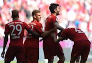 (From L) Bayern Munich's Kingsley Coman, Joshua Kimmich, Serdar Tasci and Thomas Mueller celebrate after scoring the first goal during their German first division Bundesliga match against Borussia Moenchengladbach, in Munich, on April 30, 2016 (AFP Photo/Christof Stache)