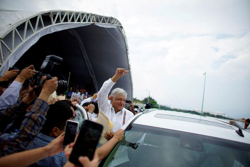 FILE PHOTO: Mexico's new President Andres Manuel Lopez Obrador reacts to supporters after an event to unveil his plan for oil refining in Paraiso