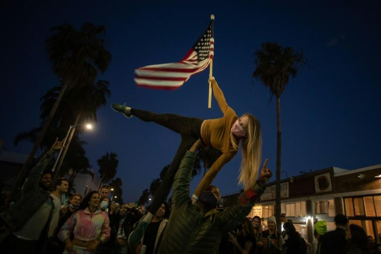 Supporters of Democrat Joe Biden support his victory in the US presidential race in Los Angeles