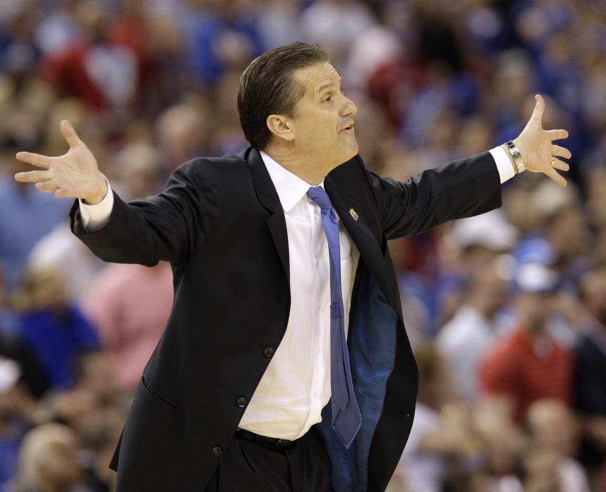 Kentucky head coach John Calipari reacts during the first half of the NCAA Final Four tournament college basketball championship game against Kansas Monday, April 2, 2012, in New Orleans. (AP Photo/Charlie Neibergall)