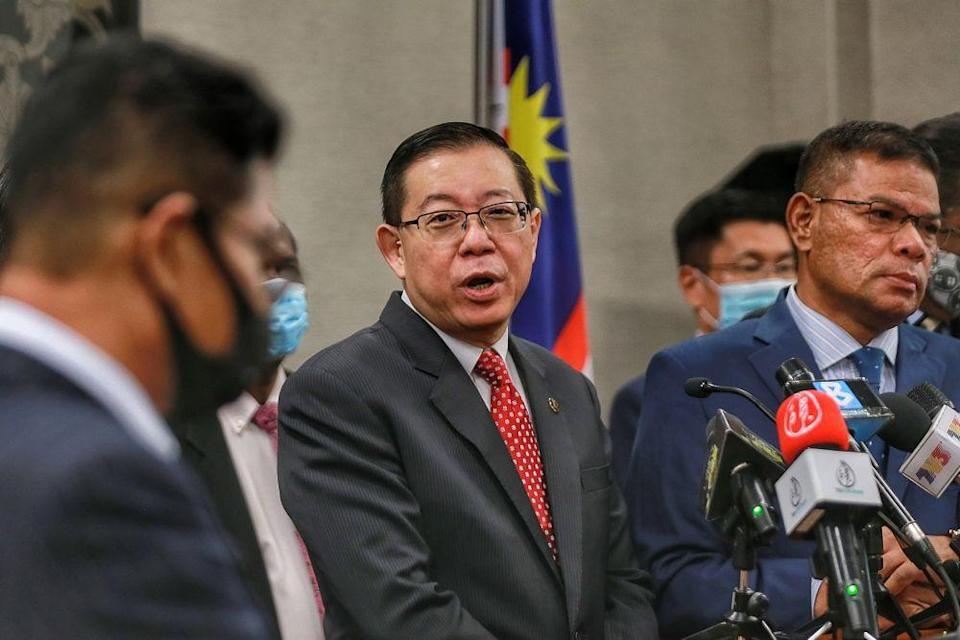 Former finance minister Lim Guan Eng speaks to reporters during a press conference at Parliament, Kuala Lumpur August 25, 2020. — Picture by Ahmad Zamzahuri